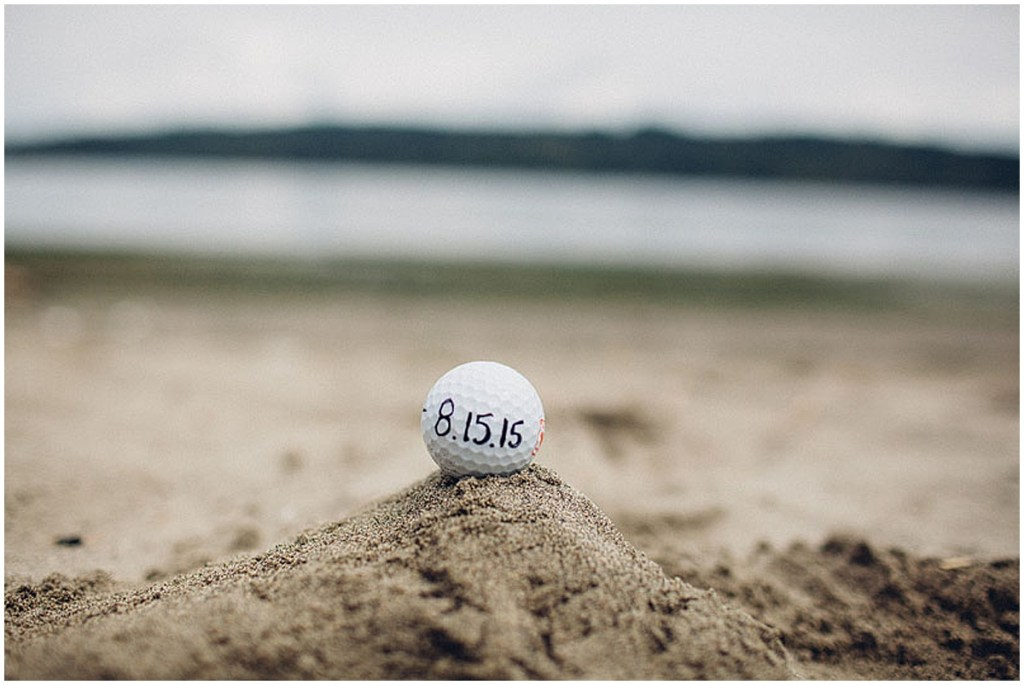 A couple's summer wedding date written on a golf ball placed on the beach in Puget Sound, Washington wedding, Perfectly Posh Events wedding planning, Washington wedding planning and coordination, Photo by Mike Fiechtner Photography