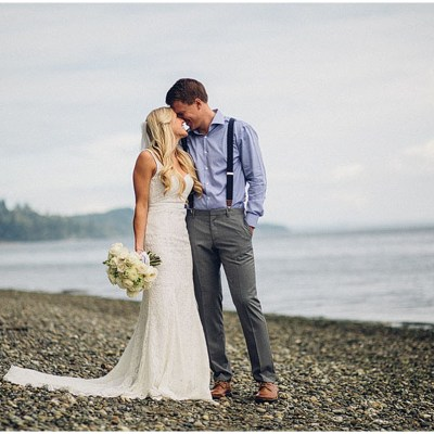 A bride and groom share a kiss before their outdoor wedding on the shores of Puget Sound, Washington wedding, Perfectly Posh Events wedding planning, Washington wedding planner, Photo by Mike Fiechtner Photography