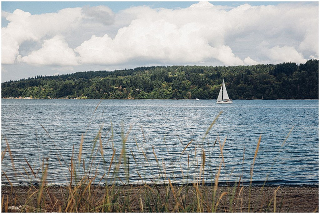 A white sail boat sails through Puget Sound in Gig Harbor, Washington on a bright summer day, Washington wedding, Perfectly Posh Events wedding planning, Washington wedding planner, Photo by Mike Fiechtner Photography