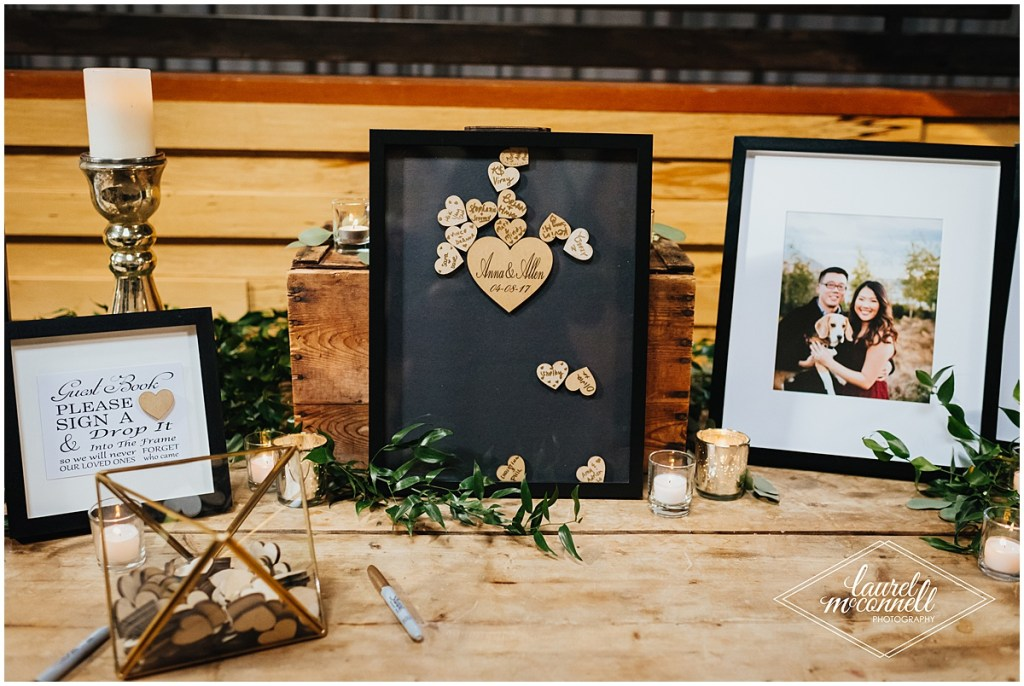 Wedding guest book with small wooden hearts dropped into a black glass frame, The Foundry by Herban Feast wedding, Seattle wedding, wedding planning by Perfectly Posh Events, Photo by Laurel McConnell Photography
