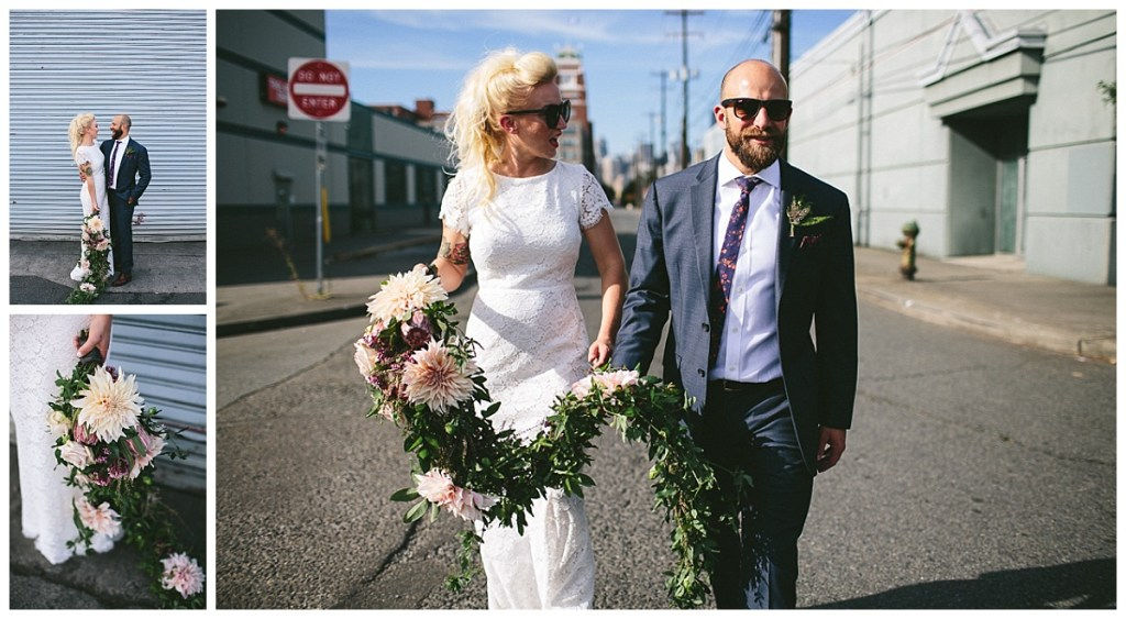 Edgy bride and groom walk into their wedding venue downtown Seattle with a long cascading bridal bouquet in hand.