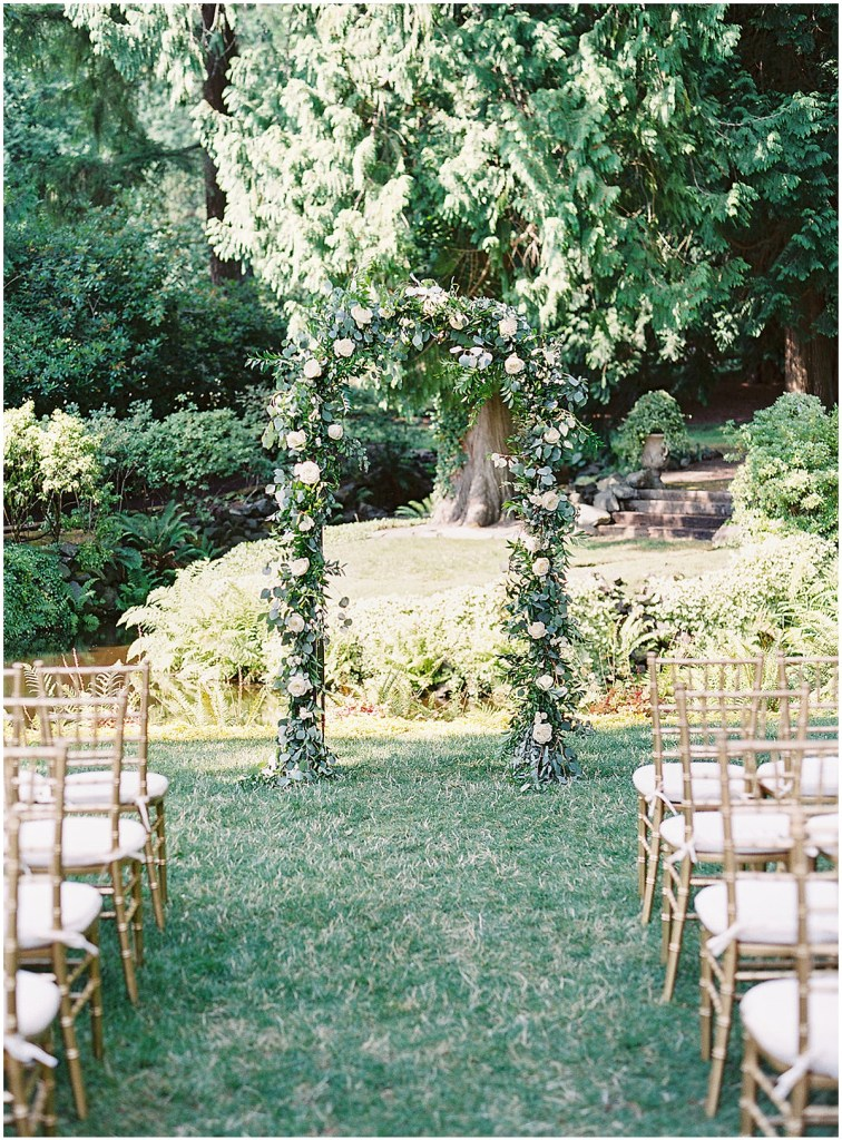 Arched wedding altar covered in green vines and blush and ivory flowers, DeLille Cellars wedding, Woodinville wedding, Perfectly Posh Events wedding coordination, Photo by Great Romance Photography