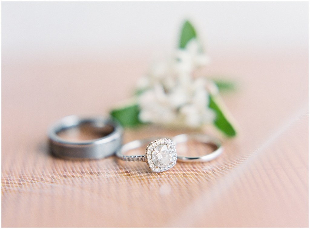 Close up of bride and groom's wedding bands along with bride's round cut engagement ring, DeLille Cellars wedding, Woodinville wedding, Perfectly Posh Events wedding coordination, Photo by Great Romance Photography