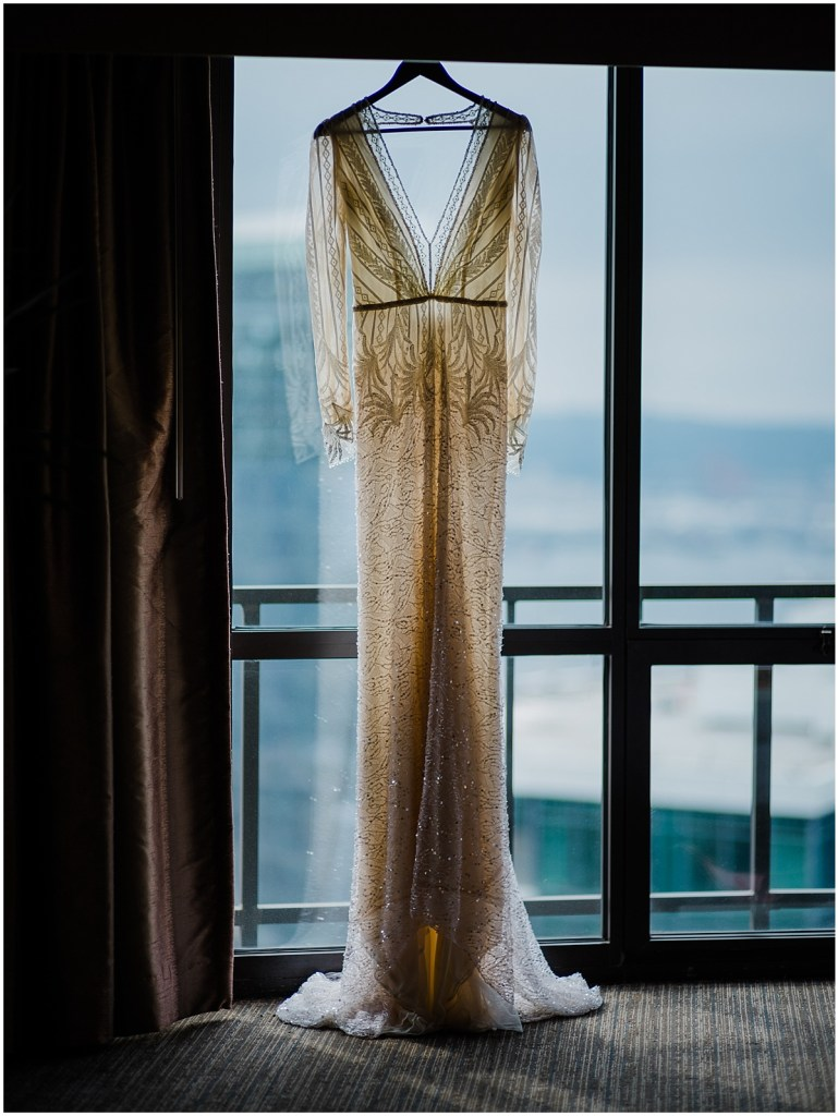 An ivory bridal gown featuring long sleeves, lace fabric, and eleborate beading, DeLille Cellars wedding, Washington wedding planner, Perfectly Posh Events, Photo by Shane Macomber Photography