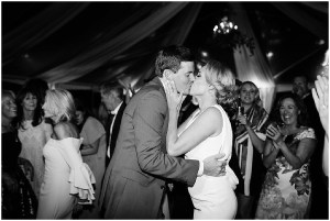 and white photo of bride and groom sharing a kiss while dancing at their wedding reception, PNW outdoor summer wedding, Washington wedding designer, Perfectly Posh Events, Photo by Kate Price Photography