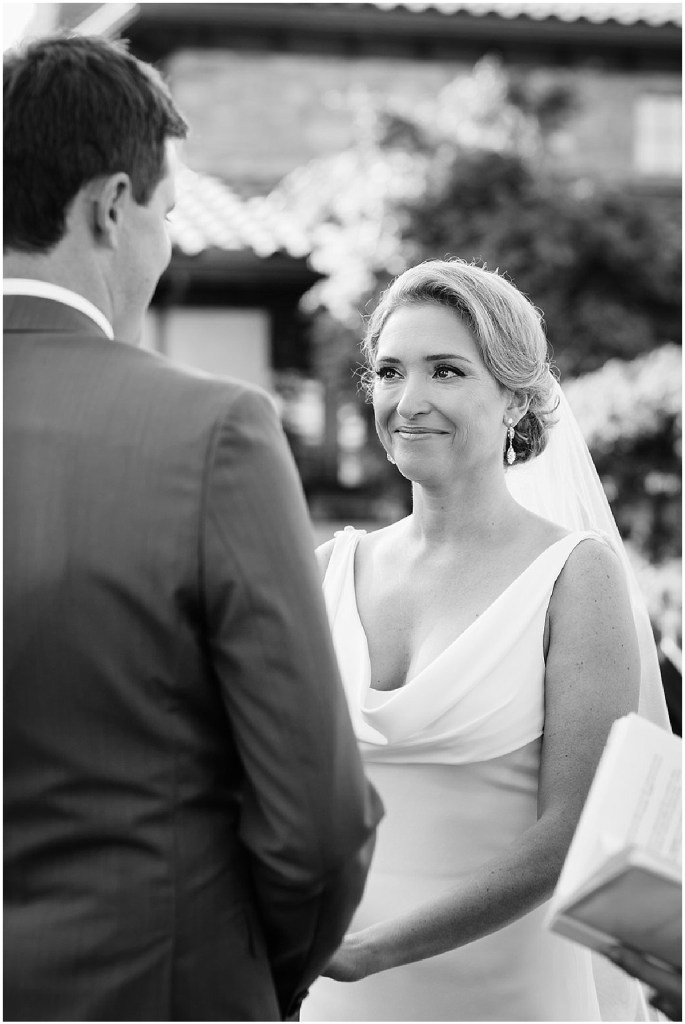 Black and white photo of bride and groom exchanging vows, PNW outdoor summer wedding, Washington wedding designer, Perfectly Posh Events, Photo by Kate Price Photography