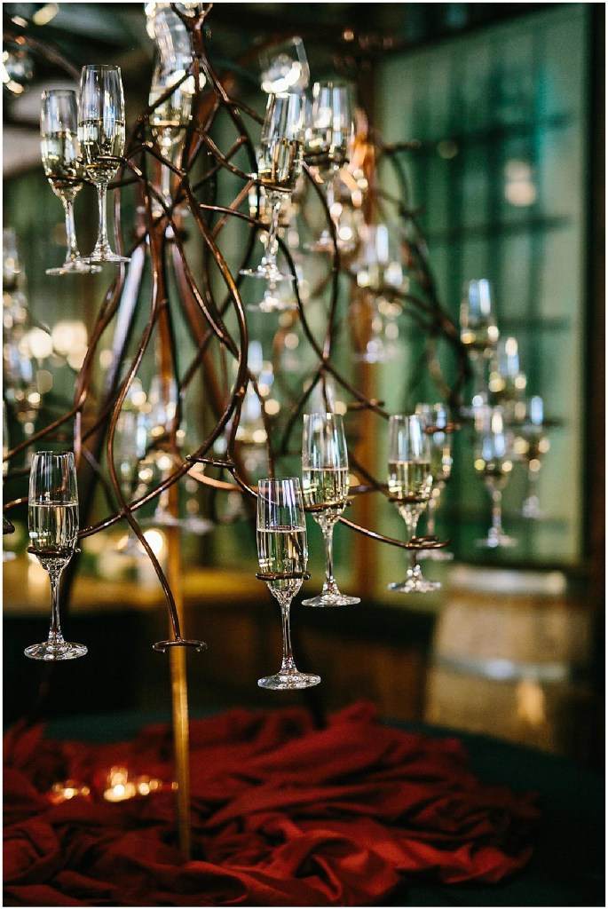 Bronze colored cocktails tree covered in champagne flutes filled with champagne, same sex wedding, Sodo Park wedding, Seattle wedding coordinator, Perfectly Posh Events, Photo by Melissa Kilner Photography
