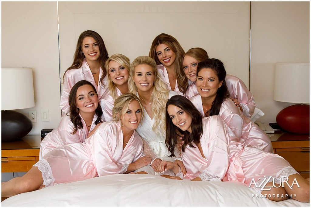 Bride smiles with her bridesmaids in pink satin gowns while getting ready for her wedding day, Four Seasons wedding, Seattle wedding, Perfectly Posh Events event coordination, Photo by Azzura Photography