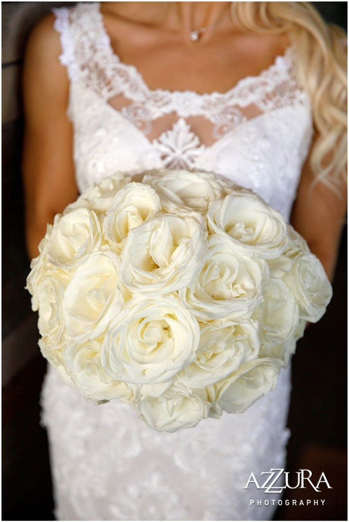 Close up of bride holding her bouquet made of white roses, Four Seasons wedding, Seattle wedding, Perfectly Posh Events event coordination, Photo by Azzura Photography