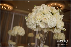 Large floral bouquet made of ivory roses and hydrangeas sits in a large clear vase, Four Seasons wedding, Seattle wedding, Perfectly Posh Events event coordination, Photo by Azzura Photography