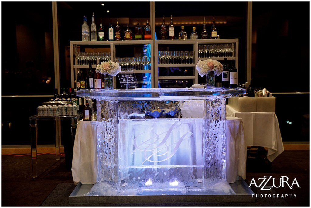 A custom made bar made completely of ice and etched with the bride and groom