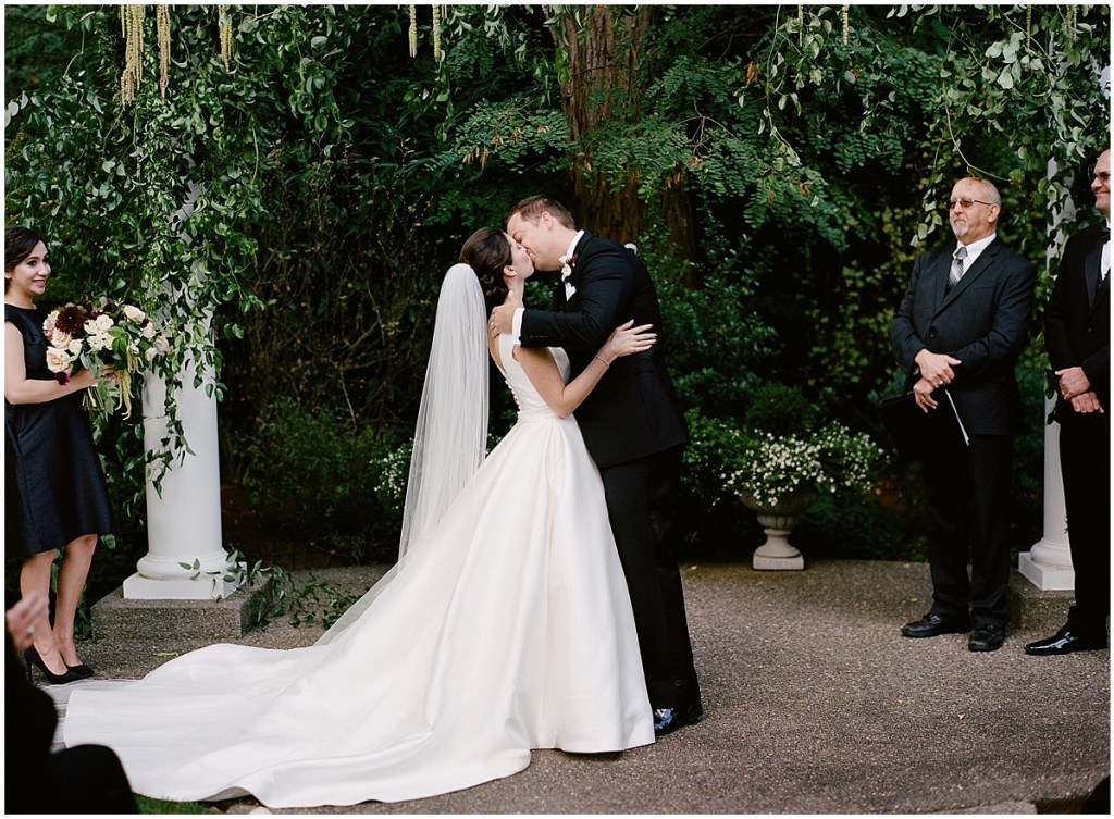 Bride and groom share a kiss after exchanging vows at their outdoor wedding ceremony, Washington wedding, Laurel Creek Manor wedding, Perfectly Posh Events wedding coordination, Photo by Katie Parra Photography