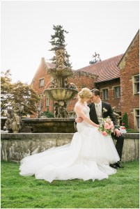 Bride and groom pose outside sitting on the ledge of a large fountain, Pacific Northwest wedding, Thornewood Castle wedding, wedding planning by Perfectly Posh Events, Photo by Stephanie Cristalli