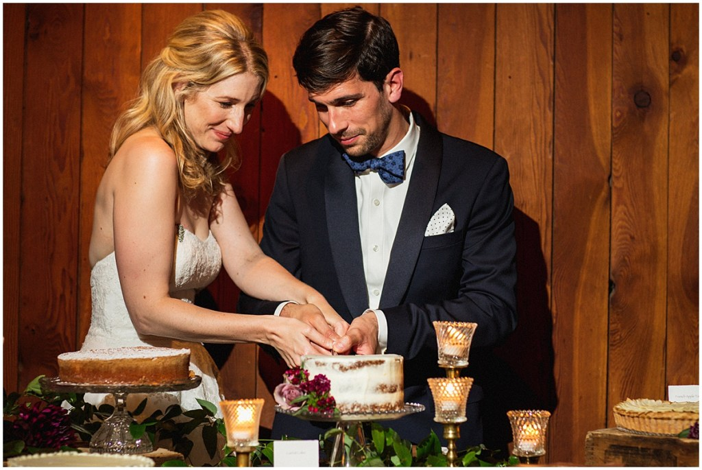 Bride and groom cut into their 'naked' frosted wedding cake, urban wedding, Within Sodo wedding, Seattle event planner, Perfectly Posh Events, Photo by Jenny J Photography