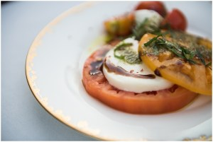 A close up a Caprese salad made with soft mozzarella, heirloom tomatoes, fresh basil, and a drizzle of balsamic dressing made for a wedding reception dinner, DeLille Cellars wedding, Woodinville winery, Washington wedding, Perfectly Posh Events wedding planning, Photo by Barbie Hull