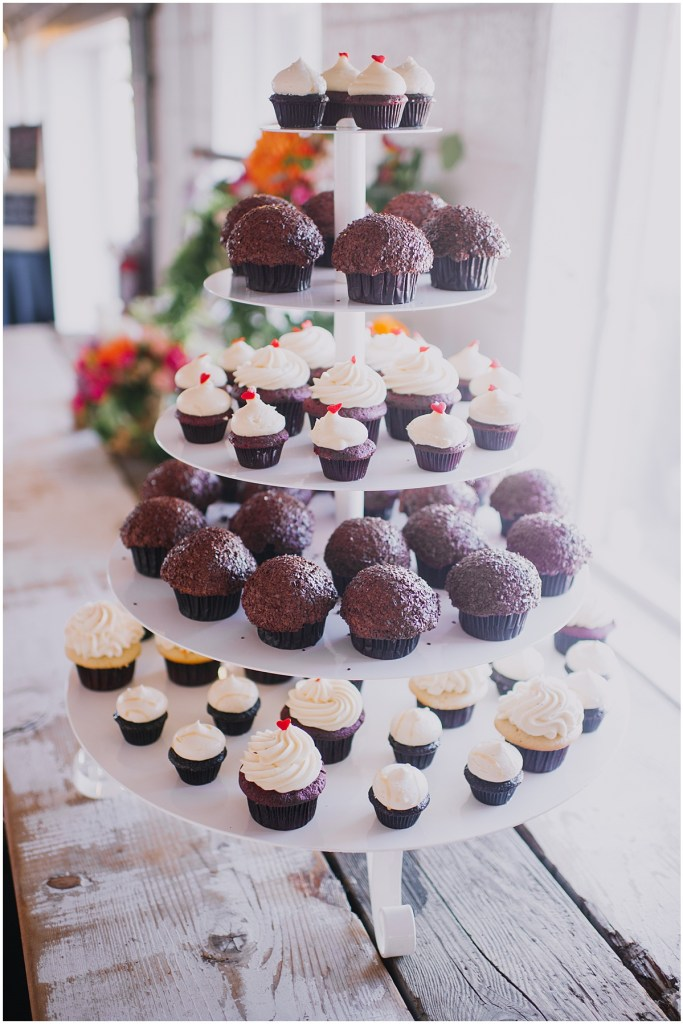 A white five-tier dessert stand filled with vanilla and chocolate cupcakes, Dairyland wedding, Snohomish county wedding, Hindu wedding, wedding planning by Perfectly Posh Events, Photo by Barrie Anne Photography