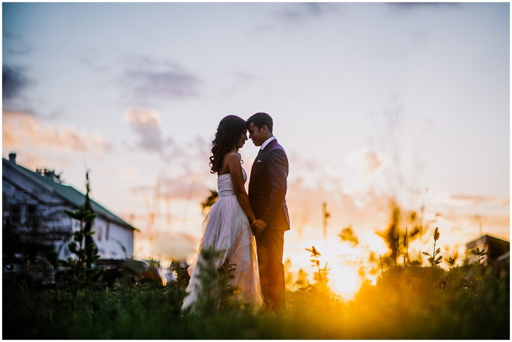 Bride and groom share a quiet moment in a flower field as the sun sets in the background, Dairyland wedding, Snohomish county wedding, Hindu wedding, wedding planning by Perfectly Posh Events, Photo by Barrie Anne Photography