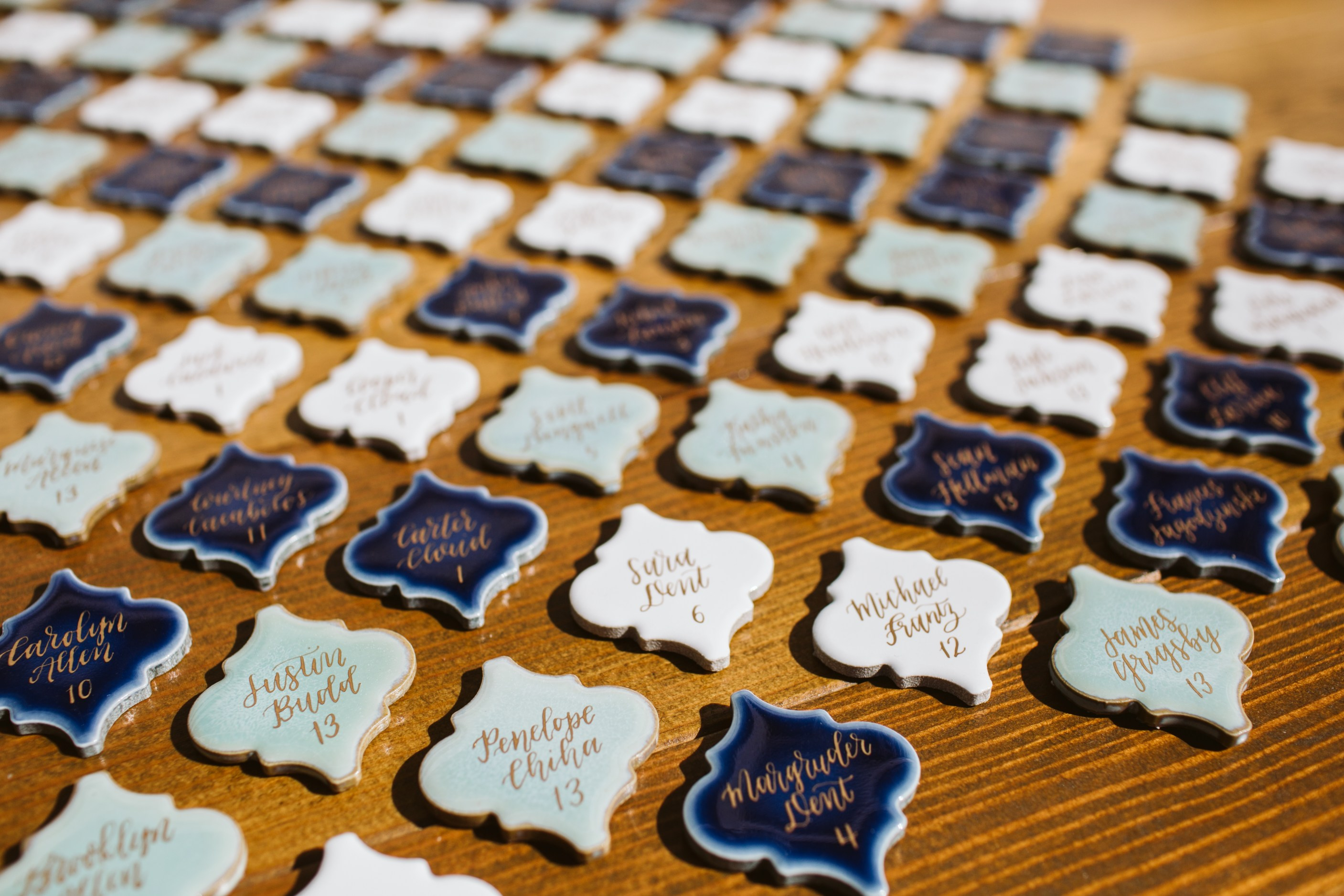 Moroccan Arabesque tiles used as place cards for your wedding reception | Tiles by Anchored Paper Co. | Sara Parsons Photography | Perfectly Posh Events www.perfectlyposhevents.com