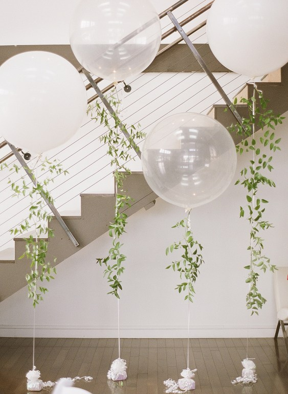 Fun white & translucent balloons at this modern classic wedding! Click for more wedding inspiration from this light + airy wedding in Seattle at wedding venue Fremont Foundry. Event planning by Perfectly Posh Events, based in Seattle and Portland. Wedding photography by Katie Parra Photography. #perfectlyposhevents