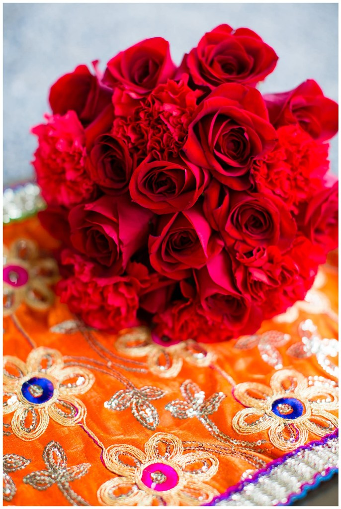 Hetal's bouquet featured bold and bright red roses and carnations.