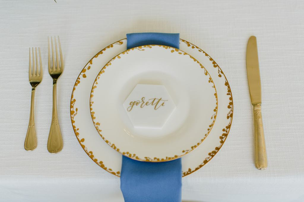 Pantone Color of the Year, Classic Blue, for 2020 is seen here in this waterfall napkin against a gold and white place setting.