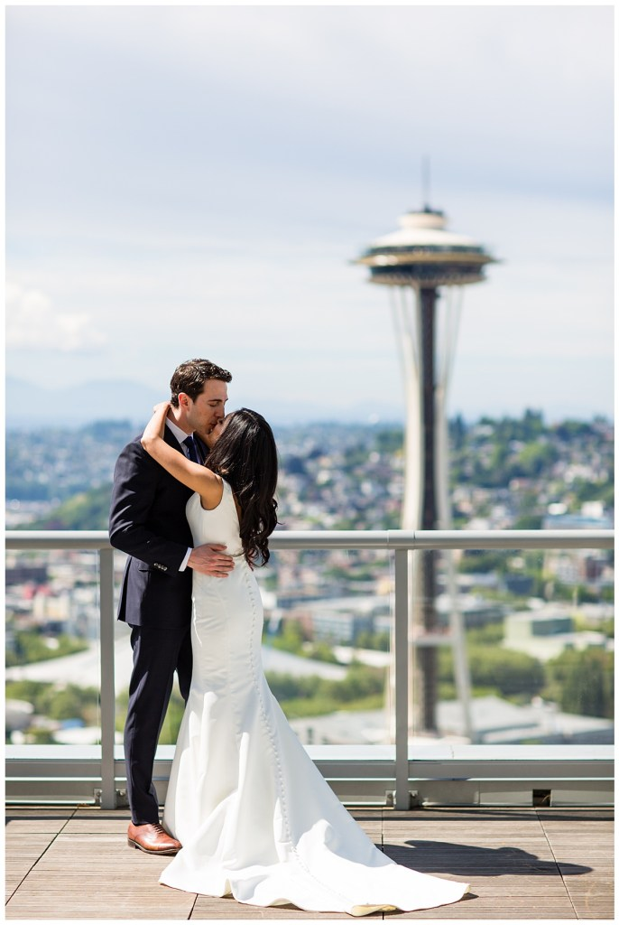 Hetal + Jake share a tender moment after their first look overlooking Seattle's Space Needle.