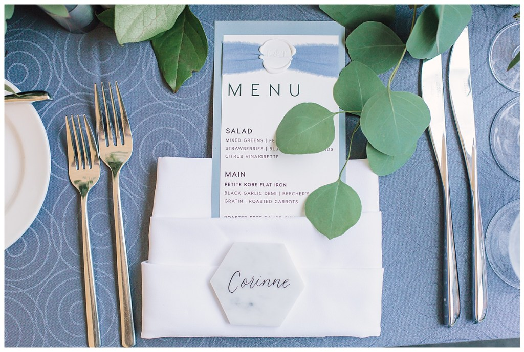 Elena + Travis mixed modern and romantic at their place settings for their reception with sleek typography and a hexagon shaped place card.
