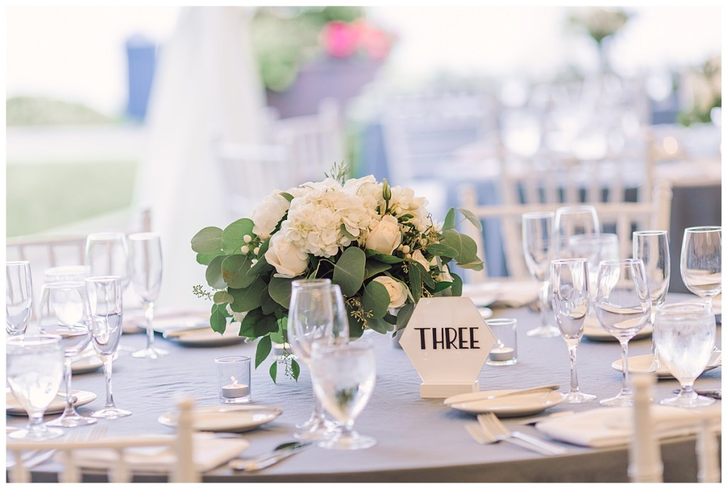 Elena + Travis's reception created visual interest with long tables and round tables, centerpieces that varied in height and lush garland. Also the hexagon-shaped table numbers kept a cohesive modern feel.