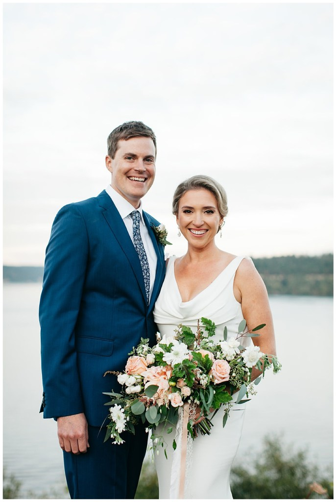 Groom navy suit and modern clean and simple white wedding dress.