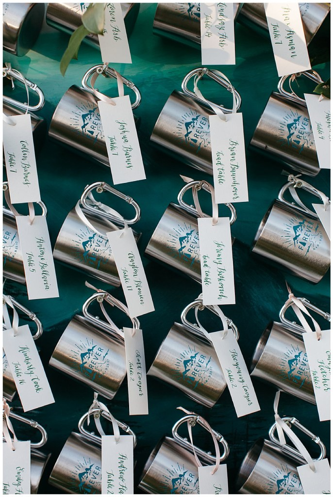 Wedding favors serve as place cards on a mug wall.