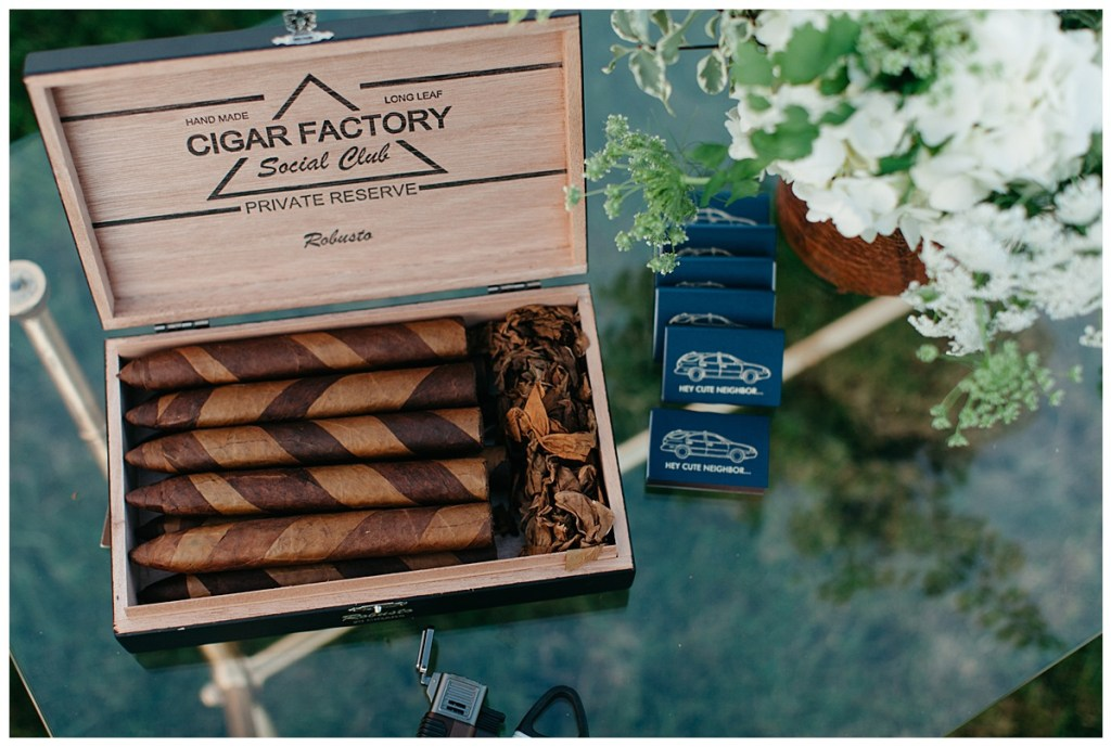Cigar bar and custom navy matchbook favors at wedding reception.