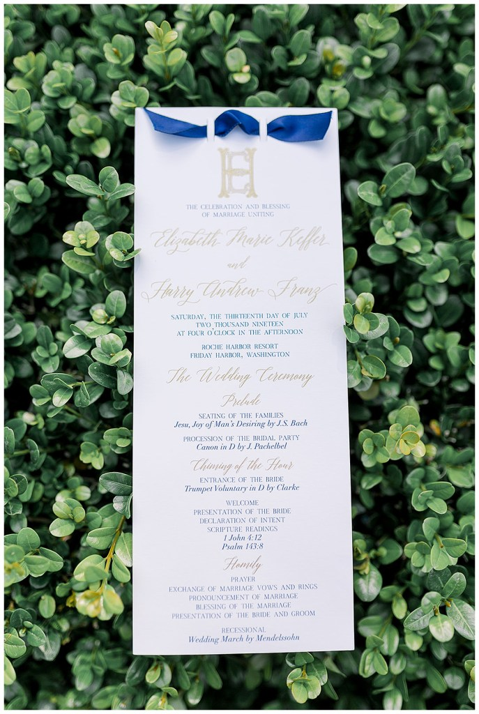 Gold and white wedding program with blue ribbon.