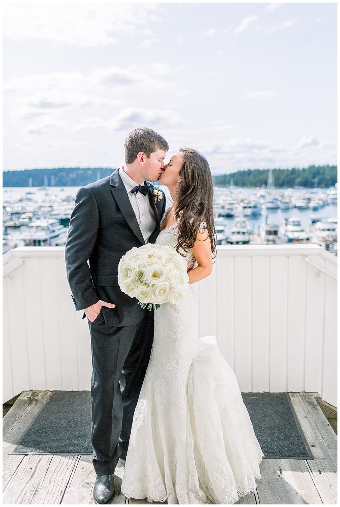 White lace wedding dress and classic white round bouquet at Roche Harbor Resort, WA.