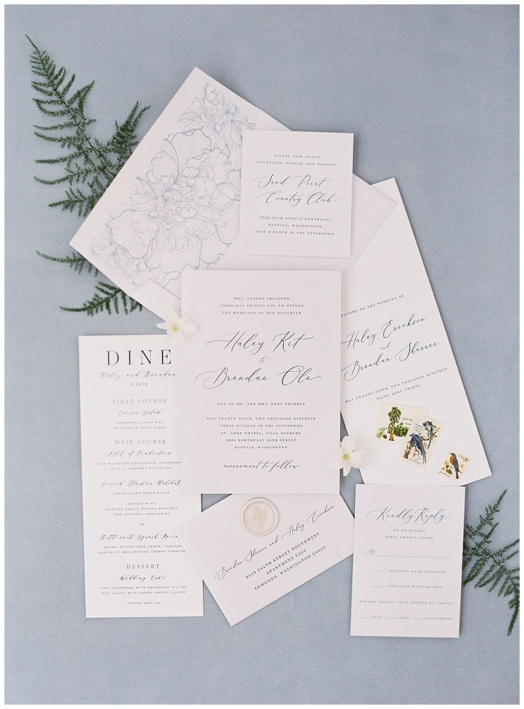 Blue and white romantic wedding invitation suite for a wedding ceremony in Seattle, WA.