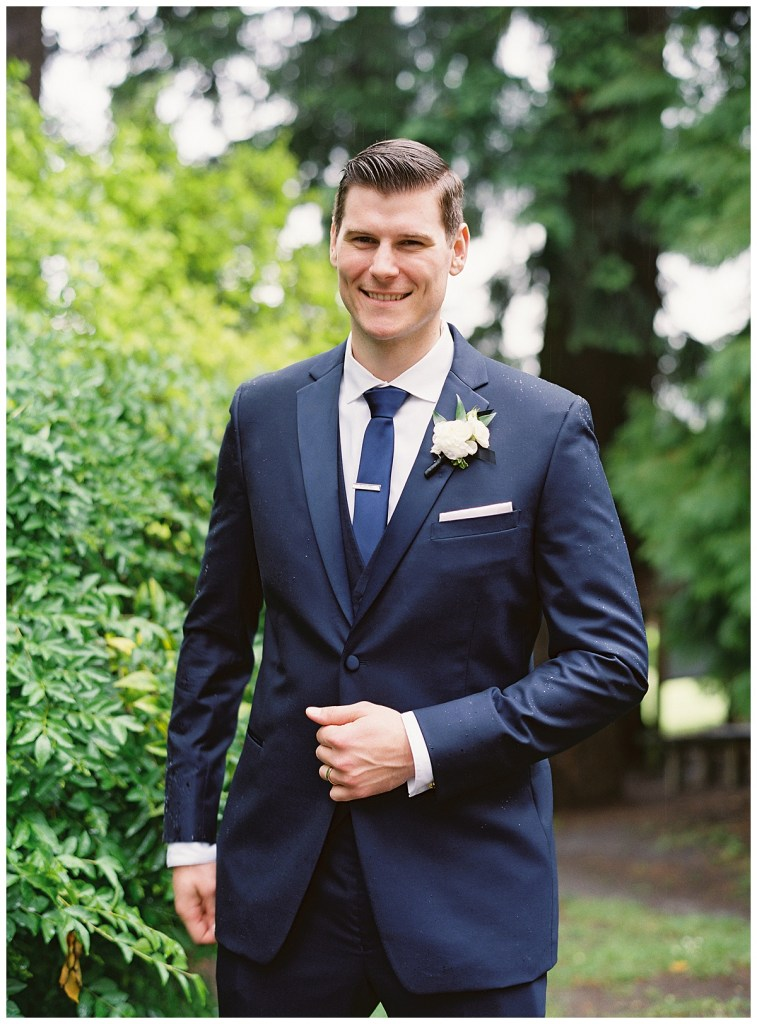 Groom navy suit and tie for wedding ceremony and wedding reception in Seattle, WA.