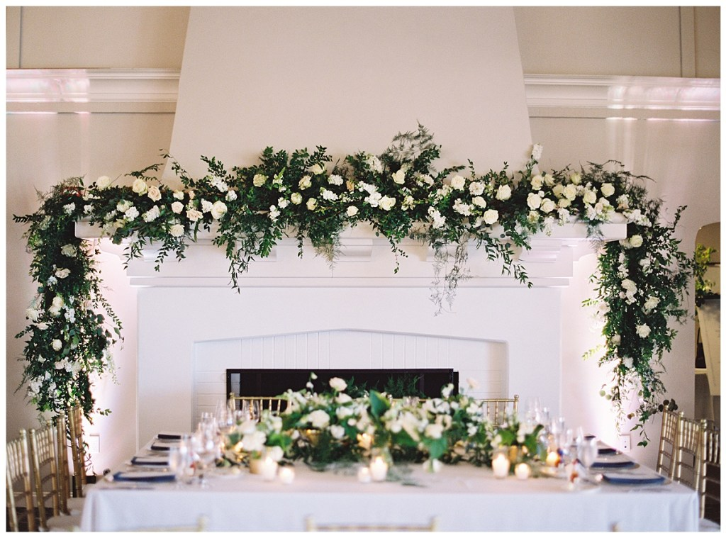 Wedding reception garland with white flowers create a focal point for the wedding reception and head table.