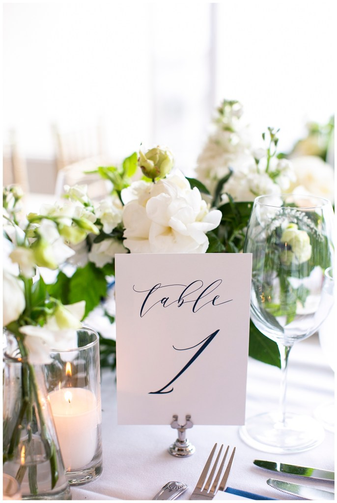 Romantic white and navy blue table number for wedding reception in Seattle, WA.
