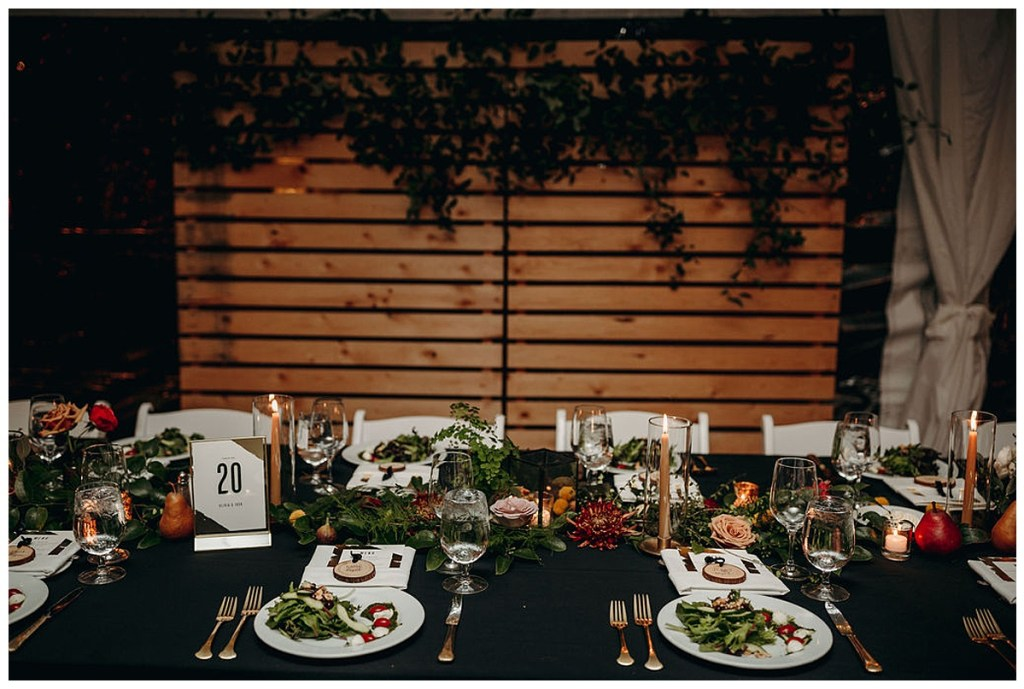 Boho head table with gold tapers and gold flatware at wedding reception in Hood Canal, WA.