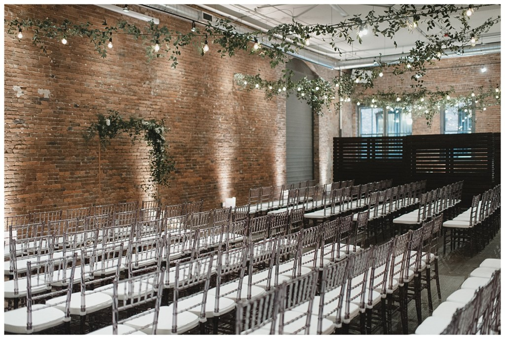 Old brick venues in Seattle with string lights for wedding ceremony. Click to see more from this urban loft wedding design for in wedding at Axis Pioneer Square in Seattle, WA. Wedding planning by Perfectly Posh Events, based in Seattle. Wedding photography by Carina Skrobecki Photography. Greenery by Rusted Vase Co.String Lights by Crimson Haze Event Lighting. #perfectlyposhevents