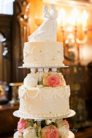 Thornewood Castle Wedding in Seattle | Elegant four-tier wedding cake with dancing couple cake topper | Perfectly Posh Events, Seattle Wedding Planner | Stephanie Cristalli Photography