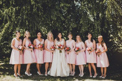 Venue: The Foundry by Herban Feast, Seattle WA | Floral Design: Butter & Bloom | Wedding Planning & Design: Perfectly Posh Events, Seattle Wedding Planner | Photographer: Carina Skrobecki Photography | Mid-century Modern wedding in Seattle, pink tea-length bridesmaid dresses