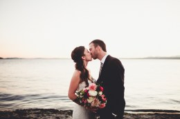 Bride and Groom kiss at sunset in Seattle, Pink and White wedding bouquet by Stacy Anderson Design, dahlias and ranuculus   Golden Gardens Bathouse Wedding   Perfectly Posh Events, Seattle Wedding Planner   Andria Linquist Photography   Holly + Dustin Wedding // © Andria Lindquist 2014