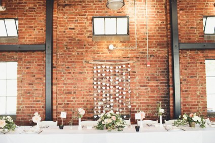 DIY headtable decor at Seattle wedding with paper hearts against brick wall | Golden Gardens Bathouse Wedding | Perfectly Posh Events, Seattle Wedding Planner | Andria Linquist Photography | Holly + Dustin Wedding // © Andria Lindquist 2014