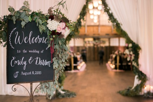 Welcome chalkboard with greenery and flower swag | Sodo Park Wedding in Seattle | Wedding Planning and Design by Seattle Wedding Planner Perfectly Posh Events | Kimberly Kay Photography | Floressence