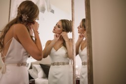 Axis Pioneer Square Wedding in Seattle   Seattle bride getting ready in classic, sleek wedding gown with beaded belt   Perfectly Posh Events, Seattle Wedding Planner   Roland Hale Photography