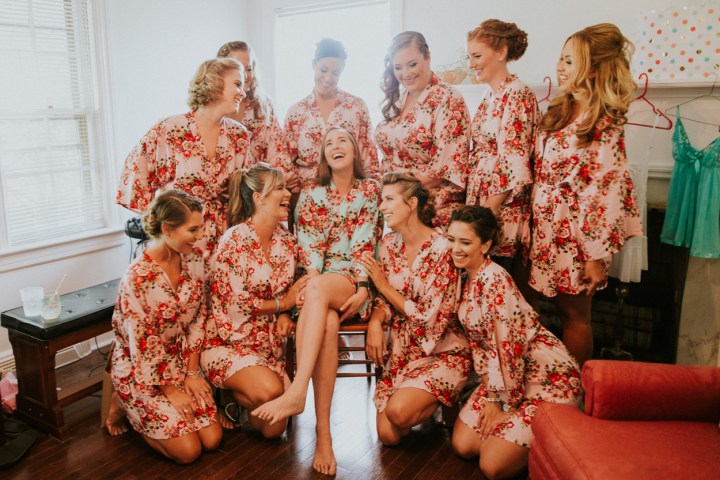 Group of bridesmaids with hair & makeup done happy and laughing