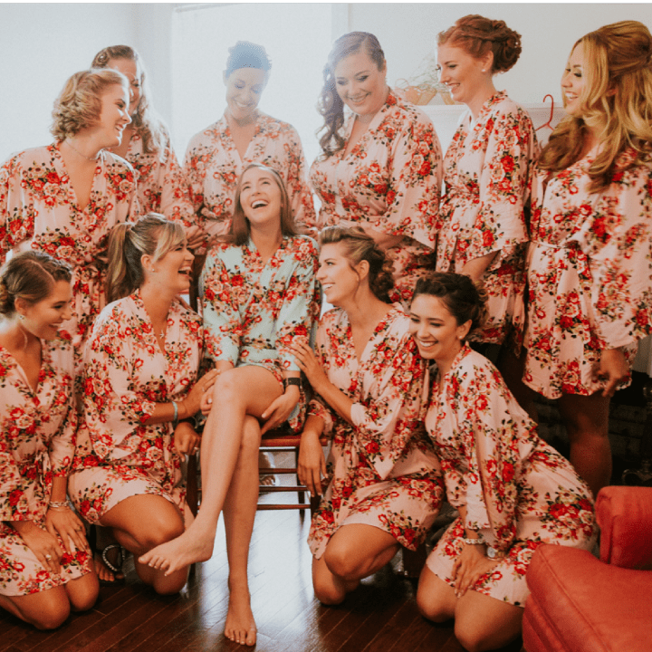 Group of women with styled hair and makeup laughing