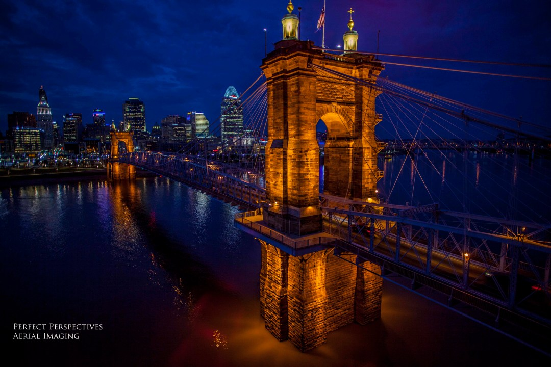 Cincinnati Drone Aerial Photography of historic Roebling Bridge glowing at night