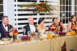 bride and groom at headtable fall weddings by perfect planning events