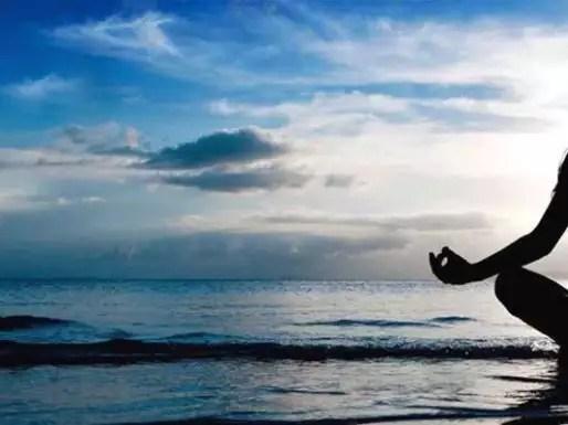 yoga-sea-beach-woman-doing-breath-retention-pose-web-header